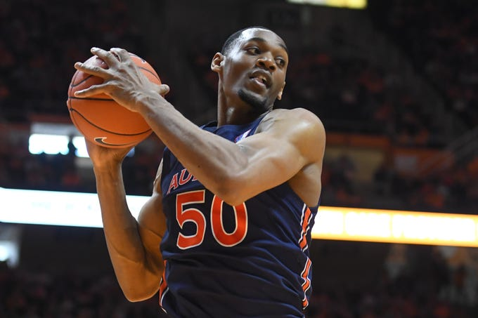Mar 7, 2020; Knoxville, Tennessee, USA; Auburn Tigers center Austin Wiley (50) rebounds the ball against the Tennessee Volunteers during the first half at Thompson-Boling Arena. Mandatory Credit: Randy Sartin-USA TODAY Sports