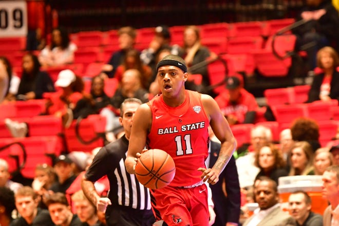 Ball State redshirt freshman guard Jarron Coleman moves the ball up the floor during the Cardinals' March 6, 2020 game against Northern Illinois.