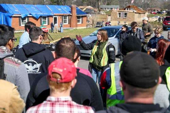 Nicki Avila, the AmeriCorps program manager working with Hands on Nashville, instructs volunteers about to disperse in the Stanford Estates subdivision of Donelson on Saturday, March 7, 2020.