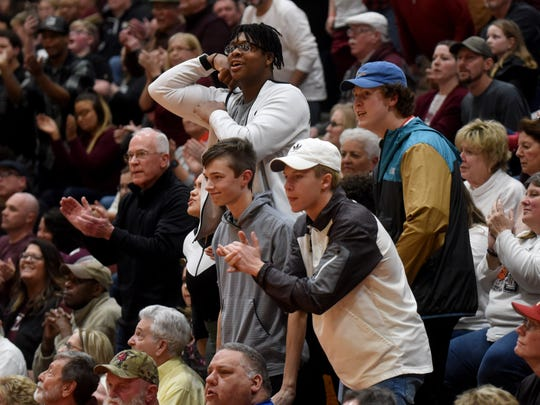 Newark fans celebrate last Friday during the Wildcats' 70-54 victory against Pickerington Central in a Division I regional final at Otterbein. Attendance will be limited for Friday's state semifinal against Canton GlenOak due to fears of the spread of coronavirus COVID-19.