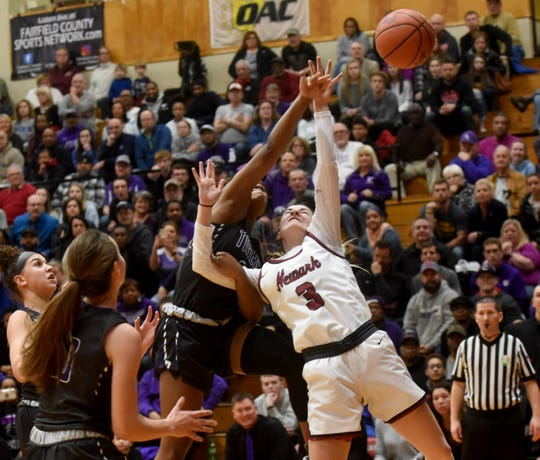 Pickerington Central senior Nadia McDowell-Jackson and Newark junior Peyton Lunsford vie for a rebound. The Wildcats advanced to the state tournament with a 70-54 win over the Tigers in Friday night's regional final at Otterbein University.