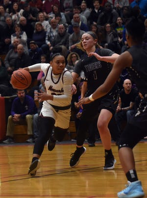 Newark senior Tamia Kendrick tries to dodge Pickerington Central junior Skye Williams. The Wildcats advanced to the state tournament with a 70-54 win over the Tigers in Friday night's regional final at Otterbein University.