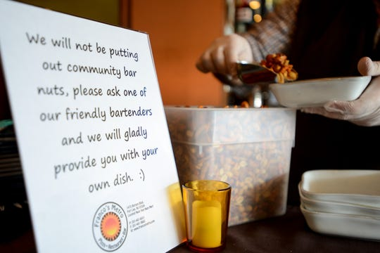 Franco's Metro in Fort Lee has implemented some new strategies to combat Coronavirus. The bar no longer has communal bowls of nuts. The bartender will give individual bowls to customers upon request. Shown on Saturday March 7, 2020.