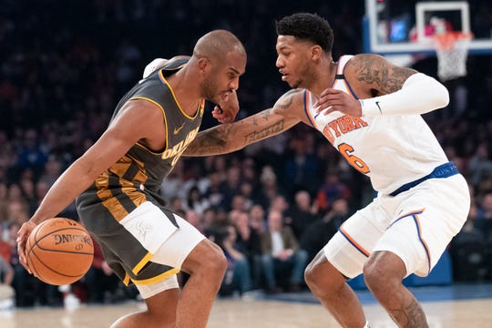 New York Knicks guard Elfrid Payton (6) guards Oklahoma City Thunder guard Chris Paul during the first half of an NBA basketball game Friday, March 6, 2020, at Madison Square Garden in New York.