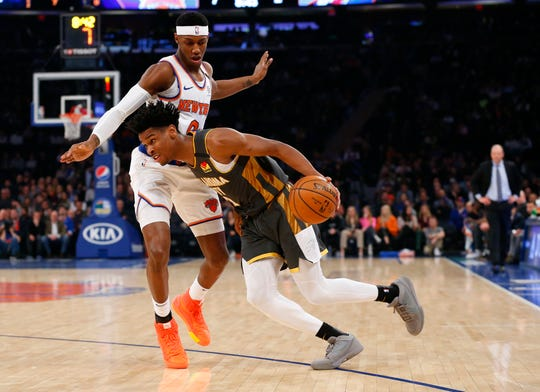 Mar 6, 2020; New York, New York, USA;  Oklahoma City Thunder guard Shai Gilgeous-Alexander (2) drives to the basket against New York Knicks guard RJ Barrett (9) during the first half at Madison Square Garden.