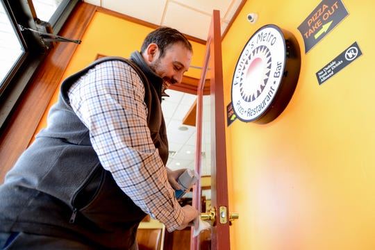 Franco's Metro in Fort Lee has implemented some new strategies to combat Coronavirus. The General Manager Gene Bazzarelli demonstrates how the staff frequently wipes down the door handles. Shown on March 7.