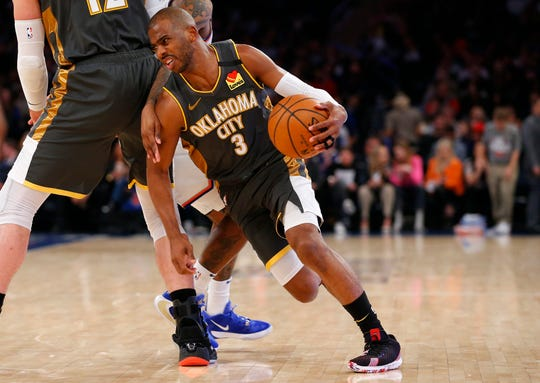 Mar 6, 2020; New York, New York, USA;  Oklahoma City Thunder guard Chris Paul (3) drives to the basket against New York Knicks guard Elfrid Payton (6) during the first half at Madison Square Garden.