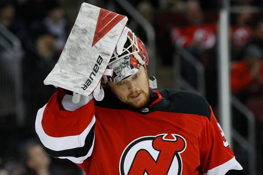 In his first home start since Oct. 30, Devils goalie Cory Schneider made 31 saves and assisted on Dakota Mermis' goal to help New Jersey defeat the Blues 4-2 on Friday night at Prudential Center in Newark.