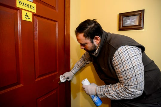 Franco's Metro in Fort Lee has implemented some new strategies to combat Coronavirus. The General Manager Gene Bazzarelli demonstrates how the staff frequently wipes down the door handles. Shown on Saturday March 7, 2020.