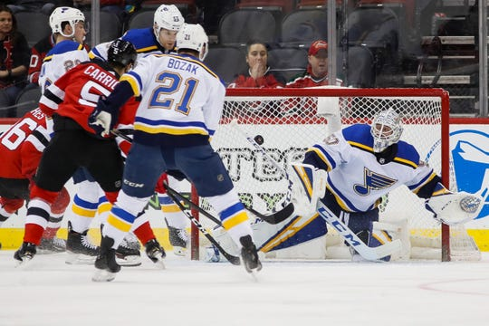 St. Louis Blues goaltender Jordan Binnington (50) makes a save during the first period of an NHL hockey game against the New Jersey Devils, Friday, March 6, 2020, in Newark.