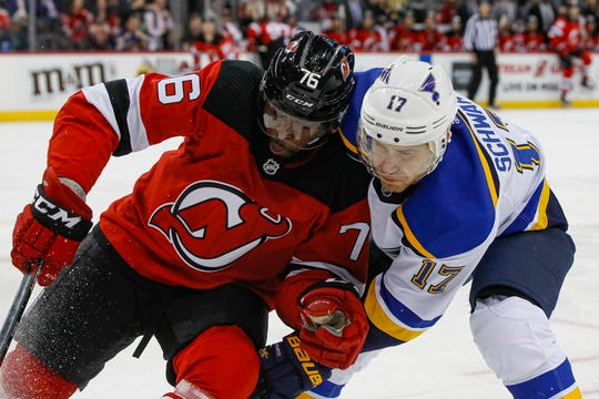New Jersey Devils defenseman P.K. Subban (76) and St. Louis Blues left wing Jaden Schwartz (17) battle for the puck during the first period of an NHL hockey game, Friday, March 6, 2020, in Newark.