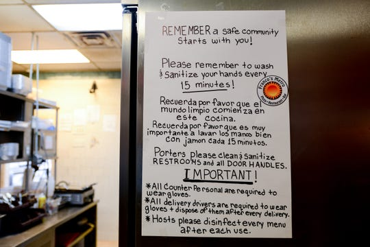 Franco's Metro in Fort Lee has implemented some new strategies to combat Coronavirus. A sign in the kitchen reminds the staff to to keep themselves and customers safe. Shown on Saturday March 7, 2020.