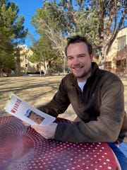 "Tyler Julian, New Mexico State University MFA student, holds his book of poetry ""Wyoming: The next question to ask (to answer),"" which was nominated for the Pushcart Prize."