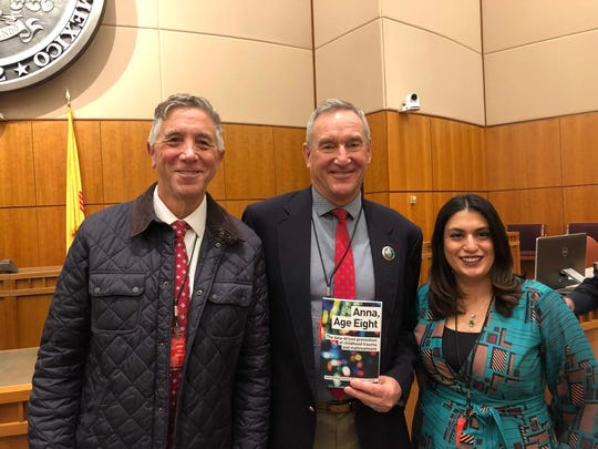 Anna, Age Eight Institute co-founders Dominic Cappello (left) and Katherine Ortega Courtney (right) with Sen. William Soules at Foster Care Appreciation and Awareness Day at the Senate chambers of the New Mexico State Capitol in Santa Fe on Feb. 1, 2020.