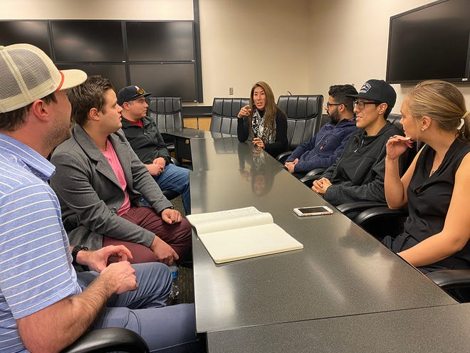 A student team from the Aggie Engineering Capstone Design Program at New Mexico State University met with Michele Nishiguchi (center), Regents Professor and Biology department head, about a project to develop a device to measure Pacific Ocean temperatures. The project is a collaboration between NMSU's College of Engineering and Biology Department and X2nSat, a full-service satellite network operator.