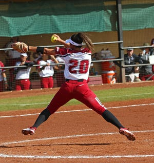 New Mexico State pitcher Felicia De La Torre throws a pitch for the Aggies.