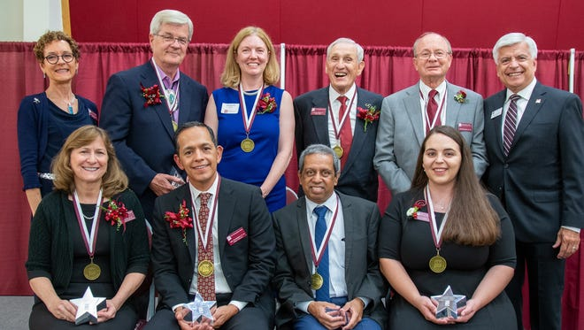The 2019 recipients of the NMSU Alumni Association awards include Jack Davis (top row, second from left), Margaret Hardin, Dr. Clenton Owensby, Van Bullock, Dr. Debra Hagler (bottom row, far left), Abel Covarrubias, Dr. Srini Kankanahalli and Natasha Nesiba. They are joined by Carol Smallwood (top row, far left), president-elect of the NMSU Alumni Association, and Chancellor Dan Arvizu (far right).