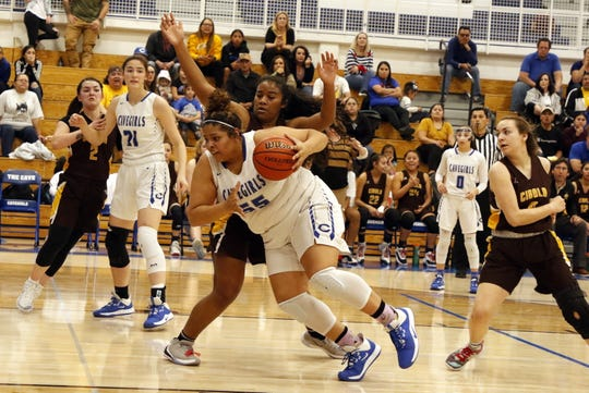 Carlsbad's Kaliyah Montoya drives the lane in the first half of their state tournament game against Cibola on March 6, 2020. Montoya scored 14 points for the Cavegirls, allowing Carlsbad a 33-29 victory to send them to Albuquerque for the fifth straight year for the 5A quarterfinals.