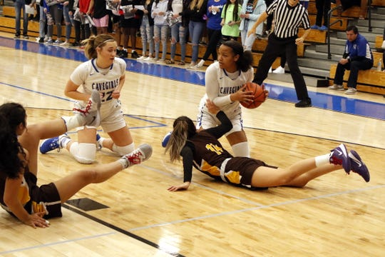 Carlsbad freshman Allie Myers gets a loose ball in the first half of the 5A first round state tournament game against Cibola on March 6, 2020. Myers finished with 10 points and Carlsbad won, 33-29.