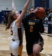 North Farmington's Maya Kelly prepares to put up a shot.