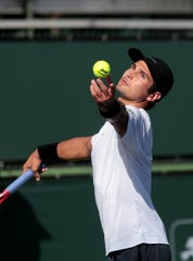 Marcos Giron serves against Brandon Nakashima during the Oracle Challenger Series at the Indian Wells Tennis Garden in Indian Wells, Calif., on Friday, March 5, 2020.
