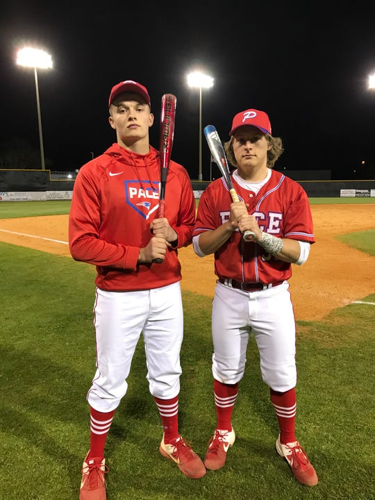 Pace baseball's Jaxon McKenzie (left) and Kobe Hesters are playing key roles for the Patriots this season.