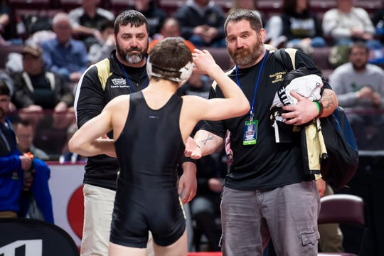 Biglerville's Levi Haines is greeted by his dad and head coach Ken Haines (right) and assistant coach Matt Showers after winning his PIAA 2A 126-pound semifinal bout at the Giant Center in Hershey Friday, March 6, 2020.