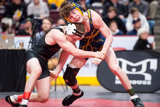 Littlestown's Connor Brown (right) wrestles Athens' Gavin Bradley in the PIAA 2A 113-pound seventh-place bout at the Giant Center in Hershey Saturday, March 7, 2020. Bradley won, 6-3.