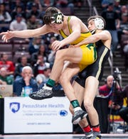 Biglerville's Levi Haines takes down Forest Hill's Jackson Arrington during the PIAA 2A 126-pound semifinals at the Giant Center in Hershey Friday, March 6, 2020. Haines won, 6-0, and advanced to his second straight PIAA championship bout.