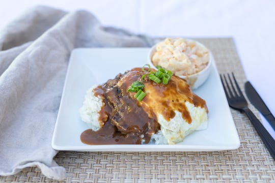 Loco Moco is popular in Hawaii. Traditionally, it includes white rice, a slice of Spam, a fried egg and gravy.
