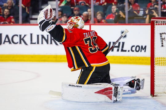 Mar 6, 2020; Calgary, Alberta, CAN; Calgary Flames goaltender Cam Talbot (39) makes a save against the Arizona Coyotes during the second period at Scotiabank Saddledome. Mandatory Credit: Sergei Belski-USA TODAY Sports