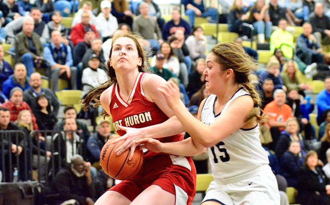 Port Huron's Emma Trombly looks to score against Macomb Dakota during a Division 1 girls basketball district championship game on Friday, March 6, 2020, at L'Anse Creuse North.