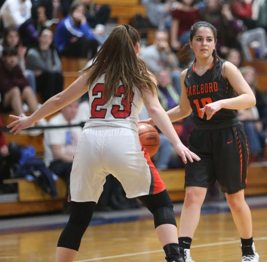 Marlboro's Brianna Bernicker takes the ball up court while guarded by Onteora's Ashley Hollard during the Section 9 Class B girls basketball final on Friday.