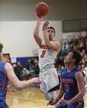 Marlboro's Alex Grzechowski takes a jump shot over Chester's Jacob Delgado during the Section 9 class B boys basketball championships in Newburgh on March 6, 2020.