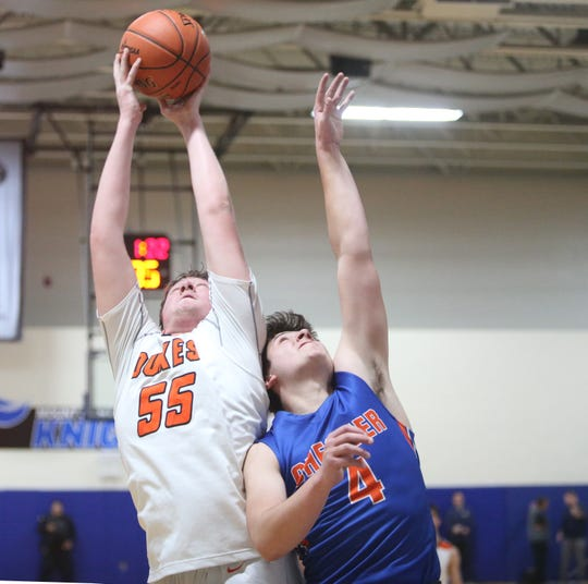 Marlboro's Justin Schwarzbeck grabs the rebound away from Chester's Joe Battiato during the Section 9 class B boys basketball championship in Newburgh on March 6, 2020.