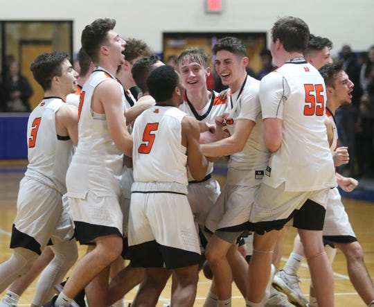 The Marlboro boys basketball team celebrates its victory over Chester in the Section 9 Class B final on Friday.