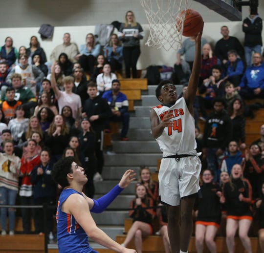 Marlboro's Chinedu Okasi takes a jump shot ahead of Chester's Kevin Stein during the Section 9 class B boys basketball championship in Newburgh on March 6, 2020.