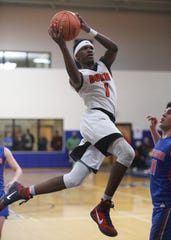 Marlboro's Korbyn Samuels takes a jump shot over Chester's Kevin Stein during the Section 9 class B boys basketball championships in Newburgh on March 6, 2020.