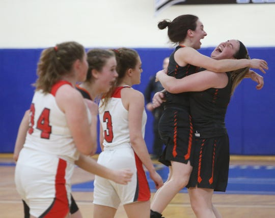 Marlboro's Elizabeth and Erin Lofaro embrace after winning the Section 9 class B championships over Onteora in Newburgh on March 6, 2020.