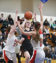 Marlboro's Hannah Polumbo takes a shot over Onteora's from left, Ashley Hillard and Lucciana Robertson during the Section 9 class B championships in Newburgh on March 6, 2020.