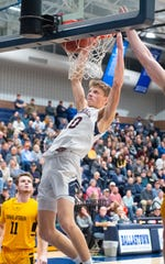 Tommy Haugh (10) dunks with authority during the PIAA 5A boys' basketball playoff game between New Oxford and Thomas Jefferson at Dallastown Area High School, March 6, 2020. The Colonials defeated the Jaguars 70-48.