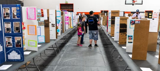 Visitors view student science fair projects at Fernley High School's STEM Festival.