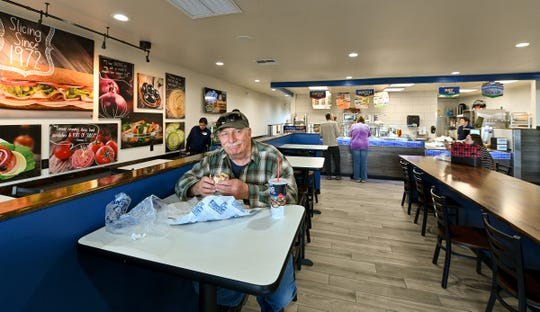 James Roche enjoys a sandwich in the newly opened Port of Subs in Yerington.