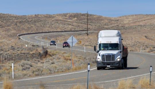 A big rig travels south on U.S. 95A towards Yerington.