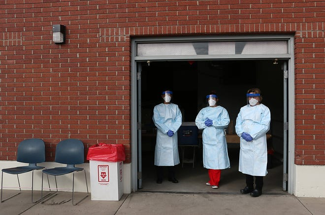 Washoe County public health nurses wait to test people for Coronavirus in Reno on March 7, 2020.