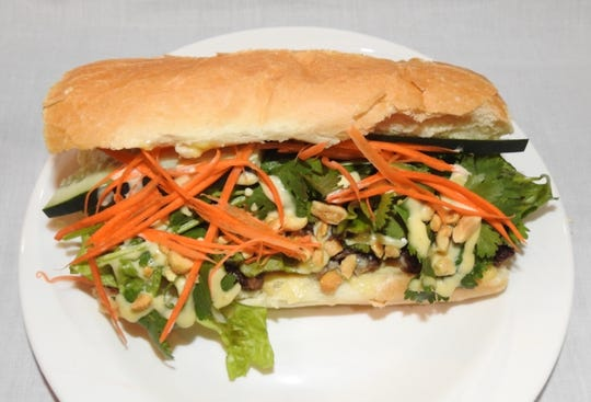 A Laotian-style banh mi from the Asian Street Eats food truck of Reno features house dressing made with sirloin drippings, garlic aÏoli, sugar, fish sauce and spurts of fresh lime juice.
