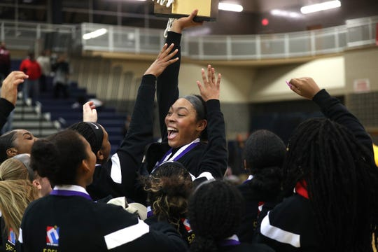 Bishop Kearney's Saniaa Wilson celebrates with teammates after winning the Class AA title with a 54-44 win over Penfield in the Section V Class AA girls basketball championship on March 6, 2020.
