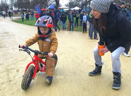 Aja Ott encourages 2-year-old son Lukas during the Swasey Shred mountain bike race organized by the NorCal High School Cycling League on Saturday, March 7, 2020.