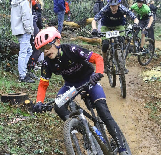 High school mountain bike racers compete Saturday, March 7, 2020, on a slick dirt trail at the Swasey Recreation Area west of Redding.