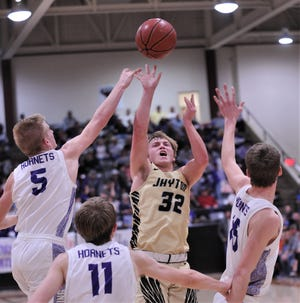 Jayton's Tye Scogin (32) shoots over Irion County's Trevin Coffell (5), Dawson Sparks (11) and Avery Theeck in the second half. Jayton won the Region II-1A semifinal 43-31 on Friday, March 6, 2020, at McMurry's Kimbrell Arena in Abilene.